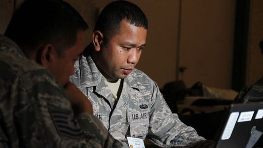 In this file photo, Staff Sgt. Visconti Christman, with the 109th Air Operations Group, Hawaii Air National Guard, defends against cyber attacks during the  2015 Cyber Security Exercise.