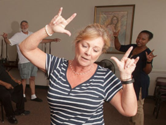 Instructor Laura Pistey teaches a Tai Chi form to a