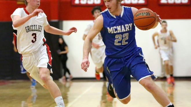 McNary's Tregg Peterson (22) races past McMinnville's Joey Chapman (3) during their game Friday, Jan. 23, in McMinnville.