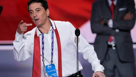 Actor Scott Baio looks over the podium during a sound