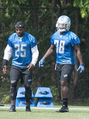 Lions' Theo Riddick, left, and Tion Green watch drills during OTAs on Wednesday, May 24, 2017 at the Allen Park practice facility.