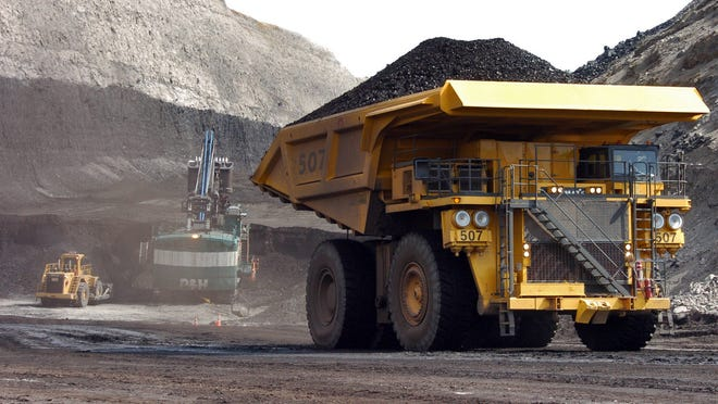 A truck carrying 250 tons of coal hauls the fuel to the surface of Cloud Peak Energy's Spring Creek mine near Decker, Montana in April 2013. In civil cases unfolding in Colorado, New Mexico and Montana, the group WildEarth Guardians asserts coal companies benefited from lax oversight by federal regulators.