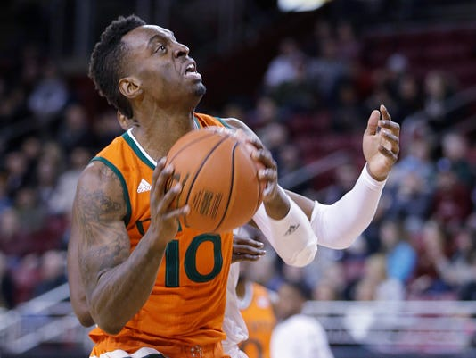 Miami guard Sheldon McClellan (10) gets by a Boston College defender driving to the hoop during the first half of an NCAA college basketball game, Wednesday, Jan. 20, 2016, in Boston. (AP Photo/Stephan Savoia)
