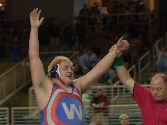 Wakulla senior wrestler Jacob Marin reacts after winning an FHSAA Class 1A state title in his heavyweight classification in Kissimmee.