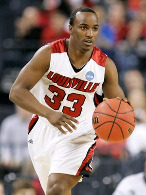 Louisville's Andre McGee brings the ball up aganst Arizona in the first half of an NCAA Midwest regional men's college basketball tournament semifinal game Friday, March 27, 2009, in Indianapolis. (AP Photo/Darron Cummings)