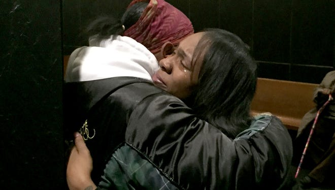 Kenyetta Moore of Detroit cries and hugs a relative after a judge ordered her father, Bernard Young, to be released from prison on Feb. 8, 2016.ÊThe proceedings were at Frank Murphy Hall of Justice in Detroit on Feb. 8, 2017.