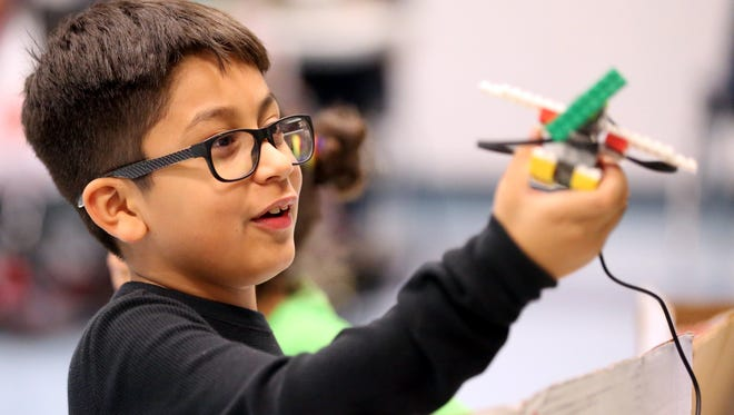 Mario Ayala plays with a robotic airplane during Science Night on Friday, Feb. 10, 2017, at Garza-Gonzalez Charter School in Corpus Christi.