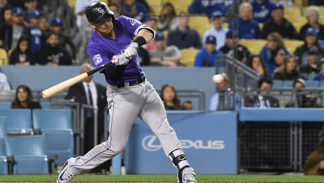 Colorado Rockies shortstop Trevor Story hits a single against the Los Angeles Dodgers in the ninth inning at Dodger Stadium.