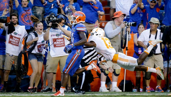 Florida wide receiver Antonio Callaway , left, crosses the goal line past Tennessee defensive back Malik Foreman, right, to score the game-winning touchdown on a 63-yard pass play during the final minutes on Sept. 26, 2015.