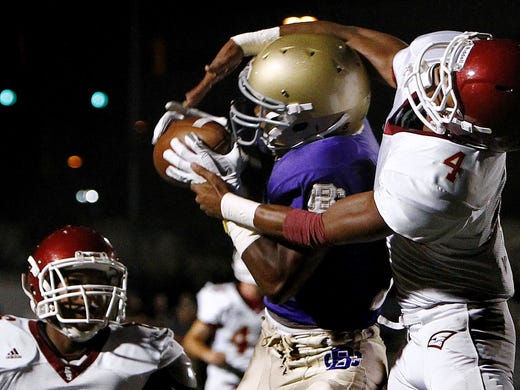 October 6, 2011 - CBHS's Anthony Miller (middle) grabs