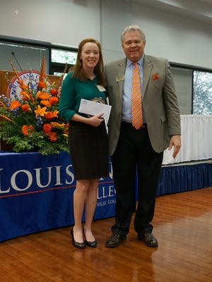Bossier City senior Makayla Anderson won Louisiana College's Smith Scholarship competition. She stands with LC President  Rick Brewer.
