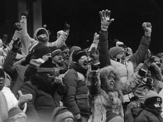 Bengals fans cheer during a game in January of 1982.