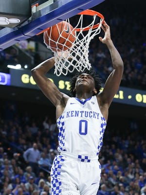 Kentucky Wildcats guard De'Aaron Fox  slams home a dunk against the Arkansas Razorbacks during the second half at Rupp Arena in Lexington, Kentucky on Saturday, January 7, 2017.