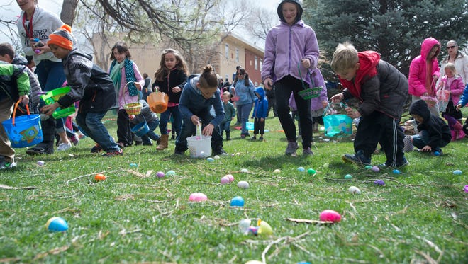 Children storm the Monfort Quad at CSU during an Easter egg hunt Saturday, March 26, 2016.