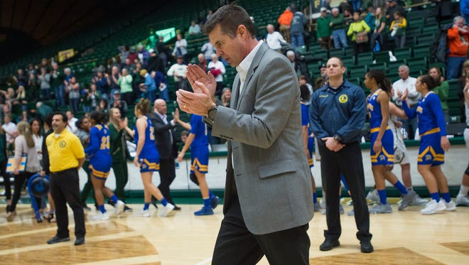 CSU coach Ryun Williams celebrates a 70-67 win over San Jose State at Moby Arena on Wednesday, January 4, 2017. The victory is Williams' 100th with the Rams.