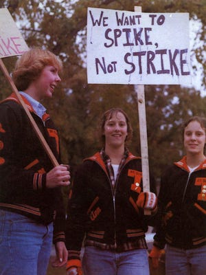 Deanne Earl, Anne Anderson and Lynn Laudenbach hold signs protesting the 1981 teacher strike, which ended many athletic seasons, including girls volleyball.