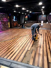 New hardwood floors will greet revelers at The Starboard's opening weekend. A $55,0000 winter.flooring project gave the Dewey Beach bar a decorative touch with maple and mahogany.