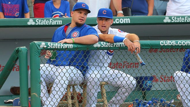 Kyle Schwarber has been a consistent presence at Wrigley Field as he rehabs knee injuries, here chatting with left fielder Albert Almora Jr.