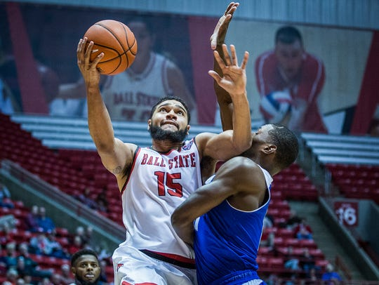 Ball State's Franko House fights for a shot past New