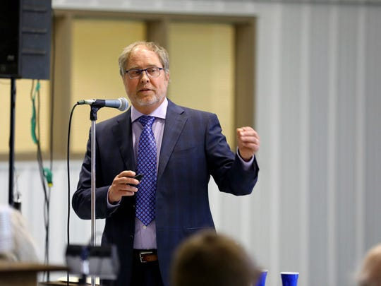 Mark Borchardt, a microbiologist with the U.S. Department of Agriculture's Agricultural Research Service, presented data on water contamination in Kewaunee County during a meeting at the Expo Hall at the Kewaunee County Fairgrounds, June 7, 2017. Scientists found both bovine and human waste are to blame.