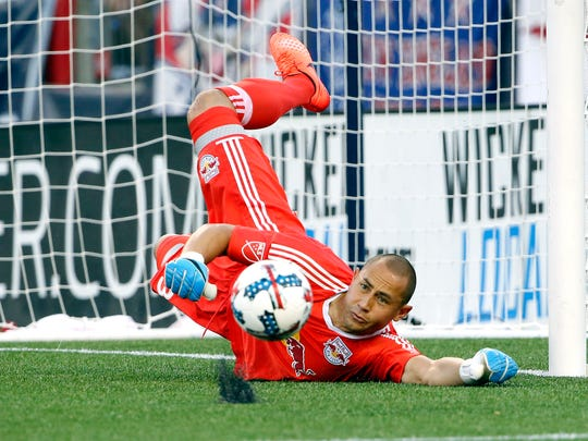 New York Red Bulls goalkeeper Luis Robles  makes a save against the New England Revolution during the first half at Gillette Stadium.