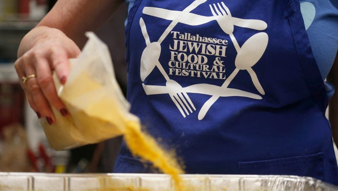 Volunteers work to create the 25 pans worth of Kugel for Temple Israel's Annual Tallahassee Jewish Food and Cultural Festival.