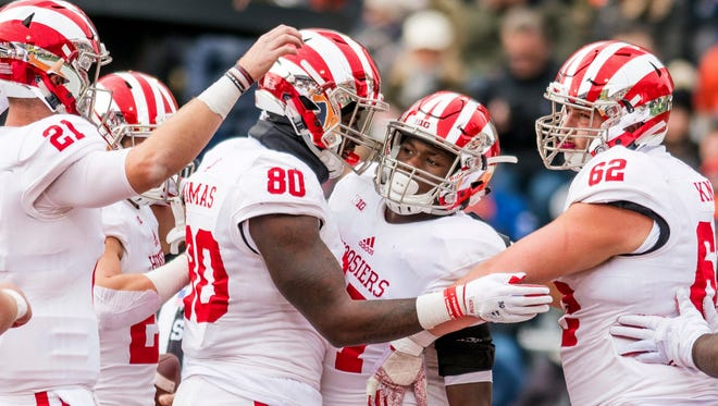 Indiana tight end Ian Thomas (80) and offensive lineman Brandon Knight (62) congratulate running back Morgan Ellison, center, on his touchdown run during the second quarter of an NCAA college football game against Illinois, Saturday, Nov. 11, 2017, at Memorial Stadium in Champaign, Ill.