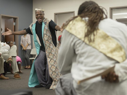 """Kirk Wendell Brown (Simonides) and Jamal Douglas (Pericles) perform at the Achievement Center of the Wilmington HOPE Commission in the Delaware Shakespeare Festival's touring production of """"Pericles."""""""
