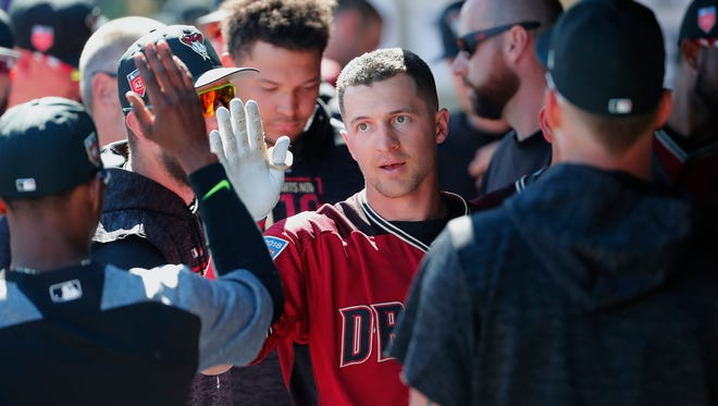Arizona Diamondbacks shortstop Nick Ahmed (13) is congratulated after hitting a solo home run against the Chicago Cubs during a spring training game at Salt River Fields at Talking Stick March 4, 2018.
