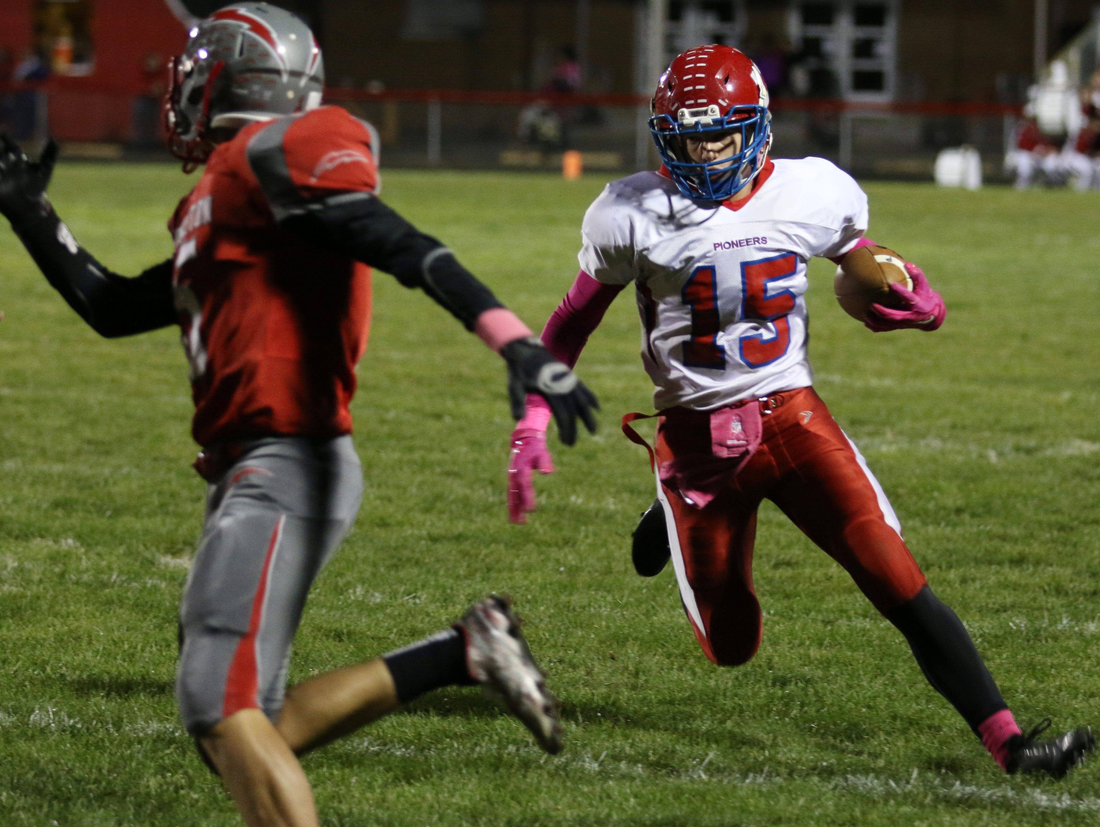Zane Trace's Alex Wolff carries the ball during Friday's contest against Piketon at Piketon High School. The Pioneers won the game, 42-8.