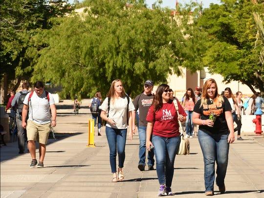 Students walk between classes on the International