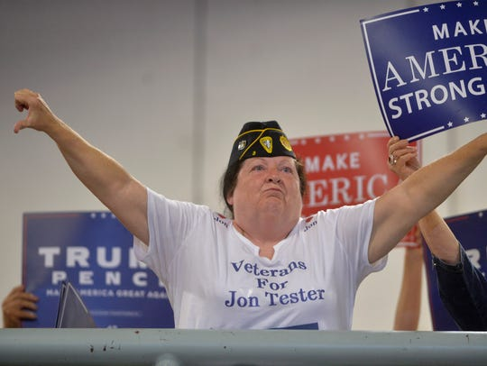 A Jon Tester supporter reacts to President Donald Trump