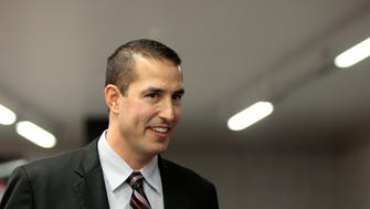 New Bearcats head coach Luke Fickell enters the room for a press conference to introduce the new University of Cincinnati football head coach in the Lindner Center on UC's campus in Cincinnati on Saturday, Dec. 10, 2016. New head coach Luke Fickell comes to UC from a defensive coordinator position at Ohio State University.