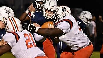 Siegel QB Brendan Crowell is wrapped up by the Oakland defense during Friday's game.