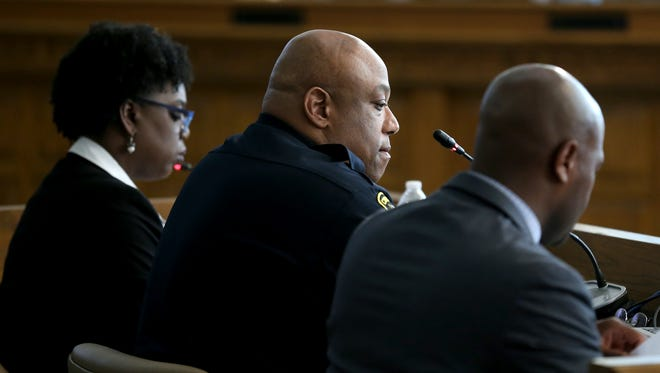 Cincinnati Police Chief Eliot Isaac, center, testifies before City Council's law and public safety committee regarding the response to the death of Seven Hills student Kyle Plush, Monday, May 14, 2018.