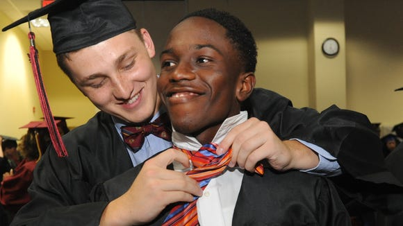 Jaylyn Folston, right, graduated from Asheville High last month.