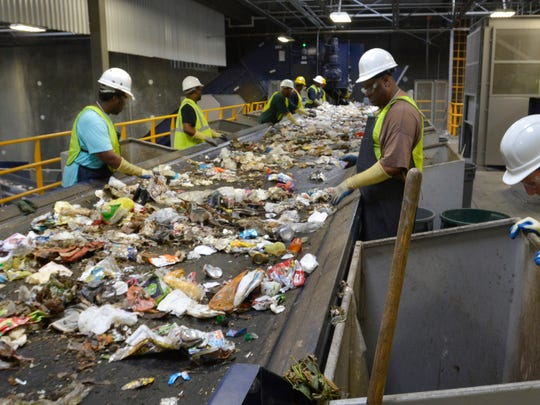 Line sorters at work during a visit the IREP Materials Recovery Facility on June 11, 2014.