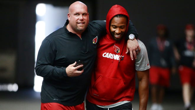 Arizona Cardinals general manager Steve Keim hugs Larry Fitzgerald on reporting day at training camp on Jul. 21, 2017 in Glendale, Ariz.