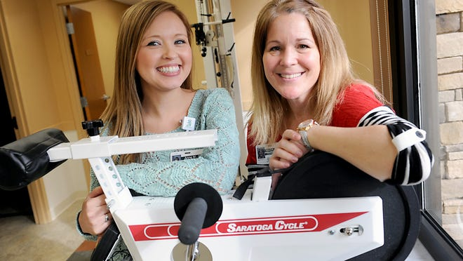 Physical therapist Anne Mellema, left, and occupational therapist Kim Hetherington, right, at the Outpatient Therapy Clinic at Burcham Hills in East Lansing Monday.