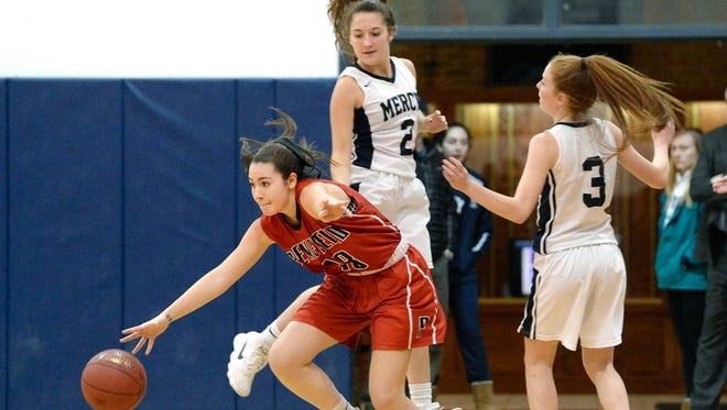 Penfield's Jessica Rinere, left, splits the defense of Mercy's Maggie McDonough, top, and Alex Hetterich during a regular season game at Our Lady of Mercy High School on Monday, Feb. 5, 2018.