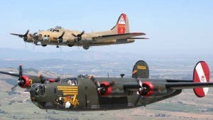 A World War II-era B-24 and B-17 take flight in the sky. The two planes will make a stop in Dutchess County this weekend as part of the Wings of Freedom Tour.