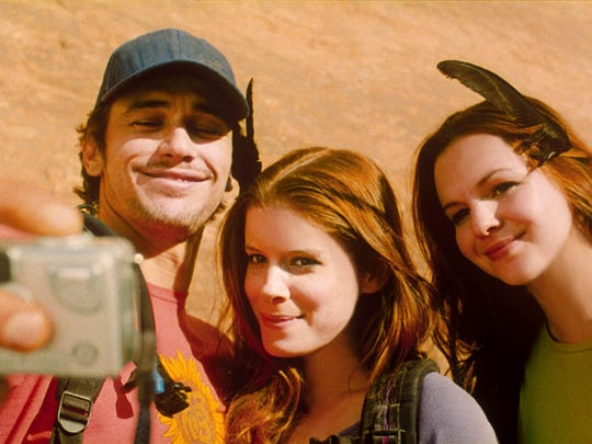 "Before things go horribly wrong, it's selfie time for Aron (James Franco, from left), Kristi (Kate Mara) and Megan (Amber Tamblyn) in ""127 Hours."""