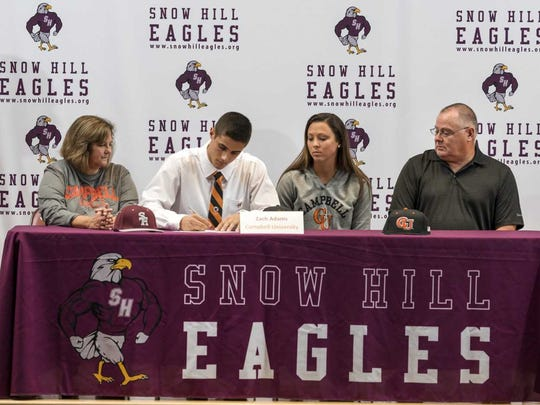 Zach Adams signs his NLI on Nov. 14 to continue his playing career at Campbell University.