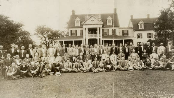 This photo shows Rotary Day at Harold and Thelma Robertson's farm in 1925. For years, this summer home of Edwin Myers was known as Meadowbrook. Now, it's known as Christmas Tree Hill in the Mansion.