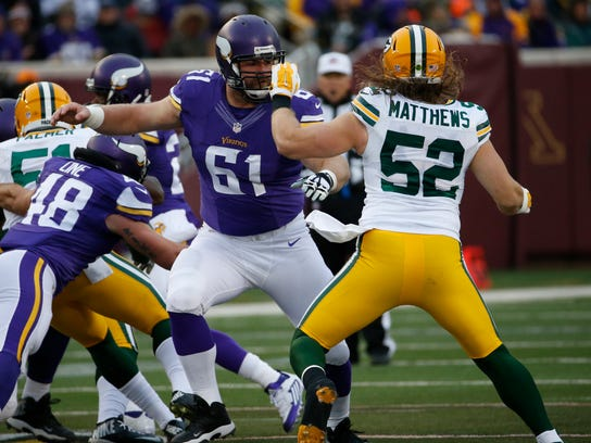 FILE - In this Nov. 22, 2015, file photo, Minnesota Vikings center Joe Berger (61) blocks Green Bay Packers inside linebacker Clay Matthews (52) during the first half of an NFL football game in Minneapolis. The Detroit Lions hosts the Minnesota Vikings in a matchup of first-place teams in the NFC North on Thanksgiving Day. One bright spot on the depleted offensive line for the Vikings has been veteran center Joe Berger, who will make his 36th straight start, a streak that began as a midseason injury fill-in for right guard Brandon Fusco in 2014. (AP Photo/Ann Heisenfelt, File)