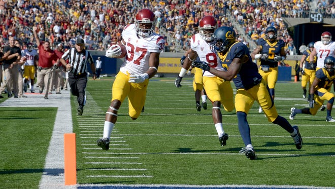 Southern California tailback Javorious Allen (37) nears the end zone on  a 43-yard touchdown run Saturday at Memorial Stadium in Berkeley, Calif.