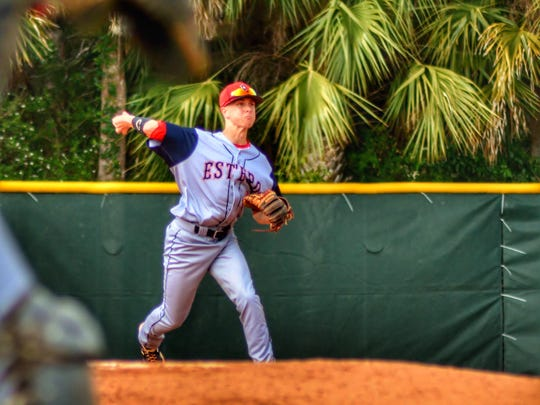 Estero's Spencer Stegemann throws the ball across the diamond during a game last season. Stegemann recently signed with Daytona State College to continue his baseball career.