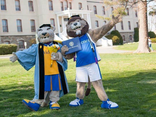 Widener's mascots, Melrose and Chester, pose for a picture before graduation. The college held tryouts this summer to find a new student to play Melrose.