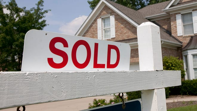 House sold sign.