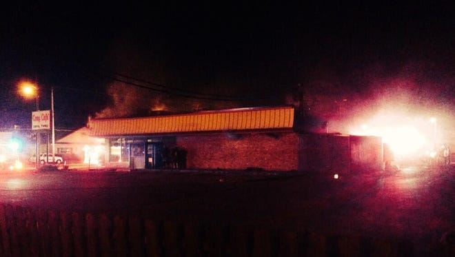 A fire burns at the Cozy Cafe, 5405 Douglas Ave., on June 5, 2014.
